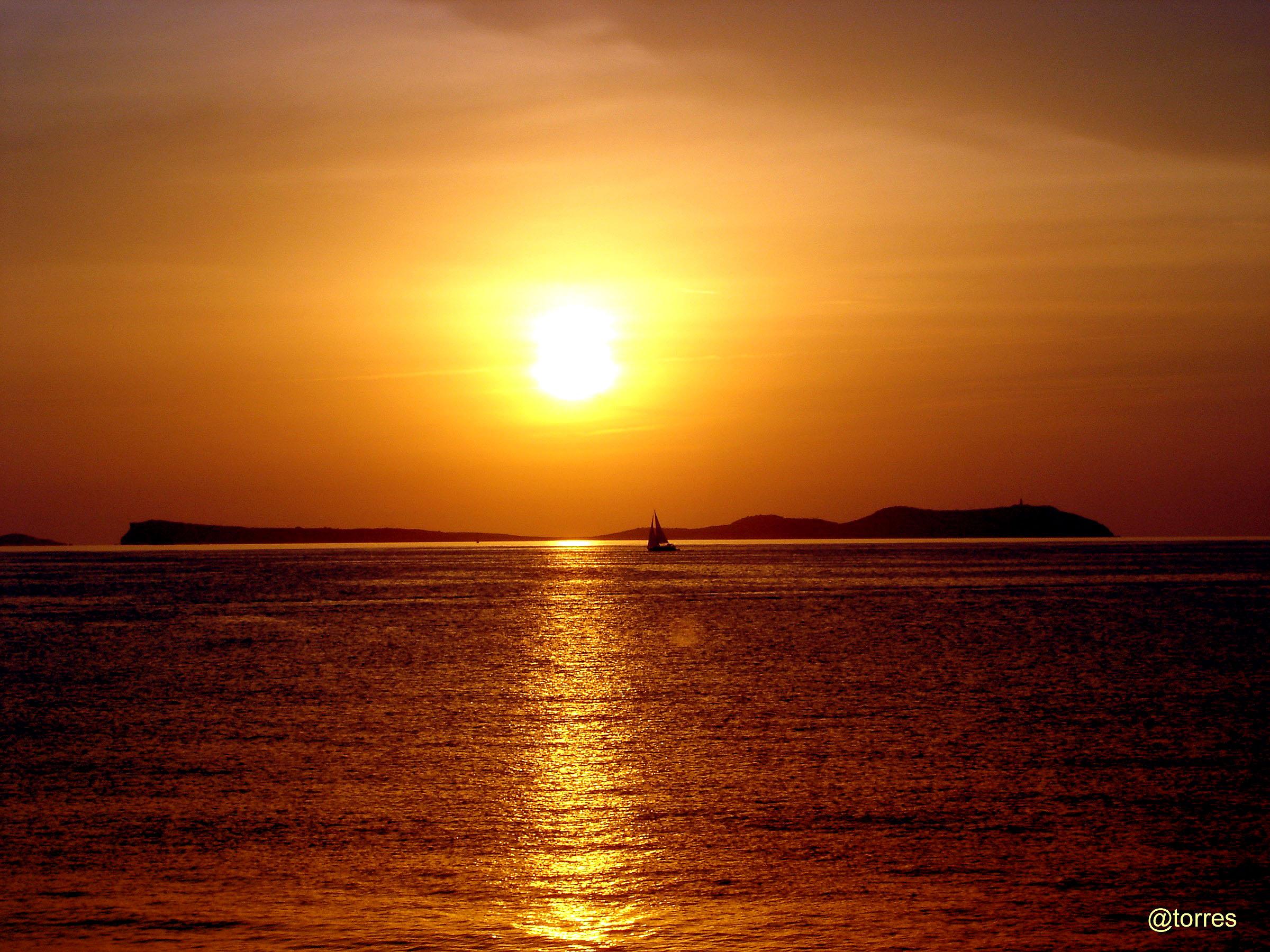 Foto playa Cala Gració. Ocaso desde Sant Antoni de Portmany, Ibiza