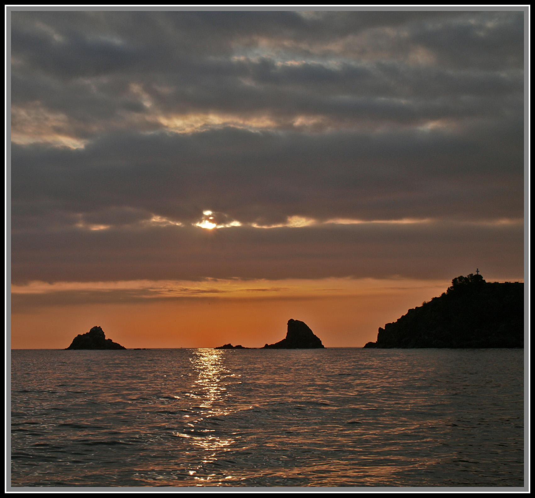 Foto playa Caletilla. Puesta de sol