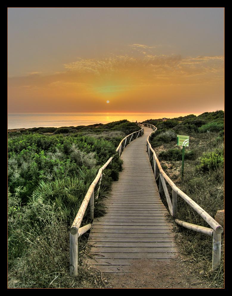 Foto playa Calas de Poniente. Puesta de Sol en Conil (Cadiz)