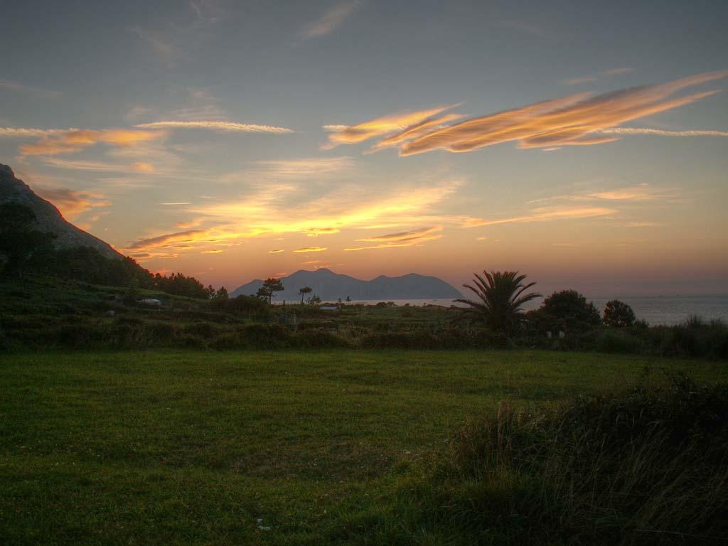 Foto playa El Berrón. Sonnenuntergang bei Sonabia