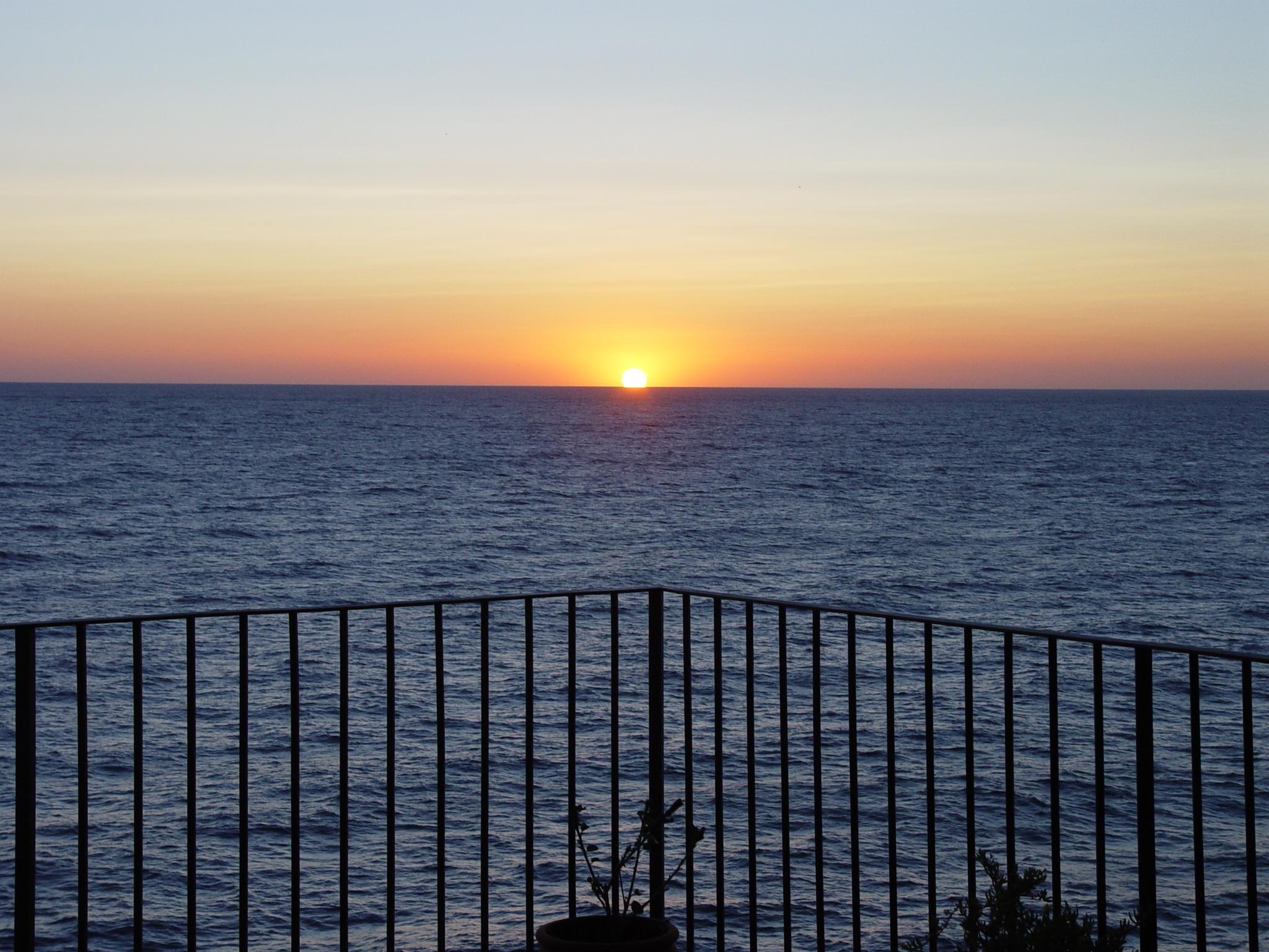 Foto playa Sa Tuna. amanecer en cap sa sal