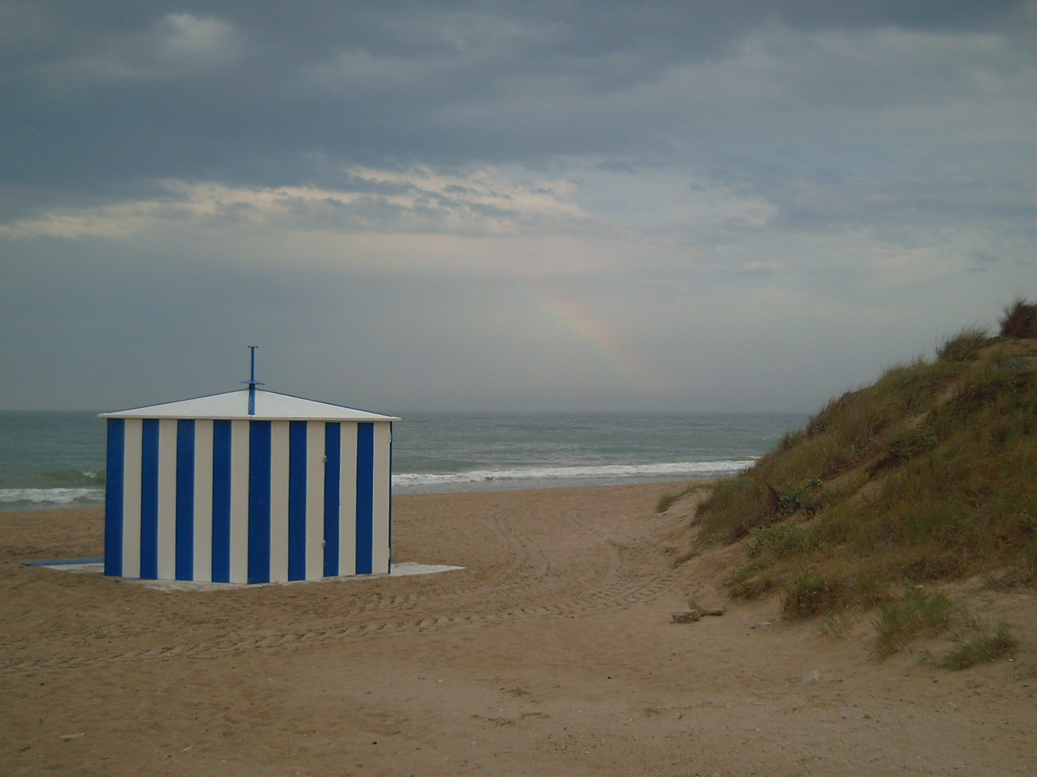 Foto playa El Perellonet / El Recatí. Amago de arco iris