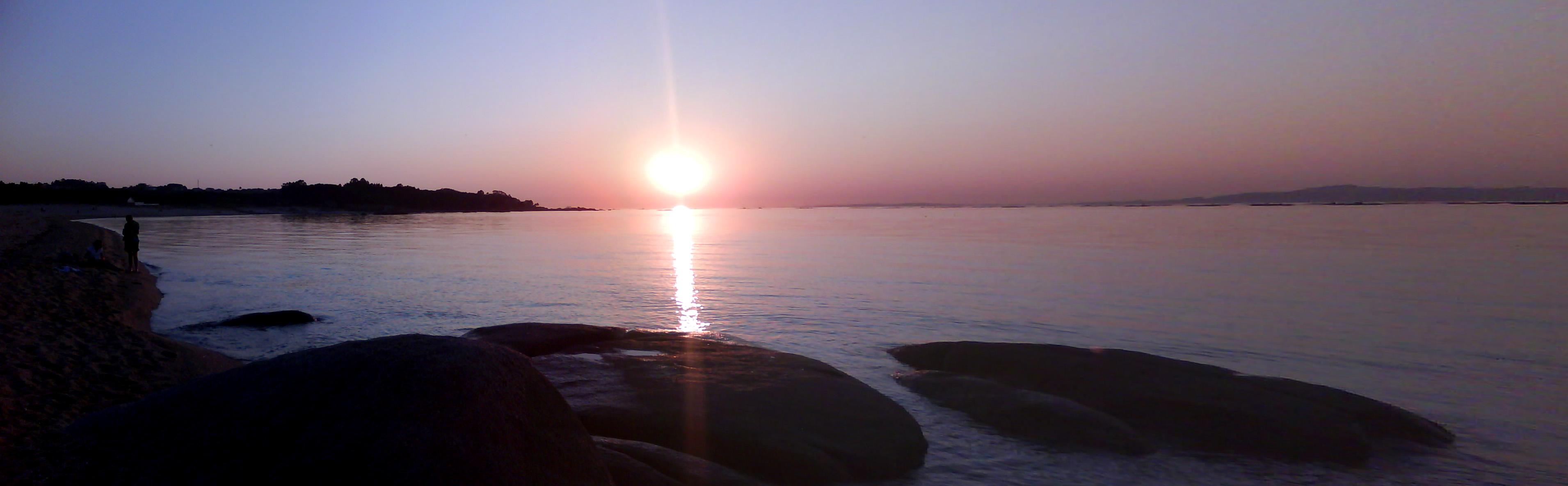 Foto playa Eiron. Boca de ría se come el sol