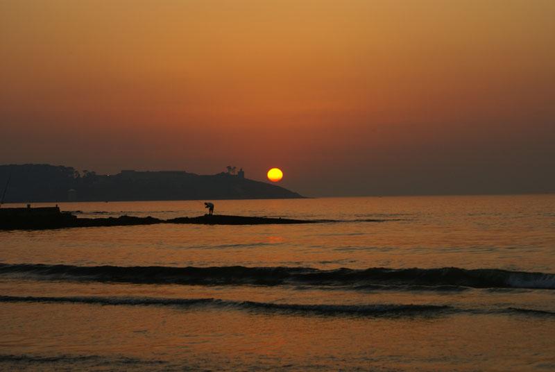 Foto playa América. por do sol em praia america