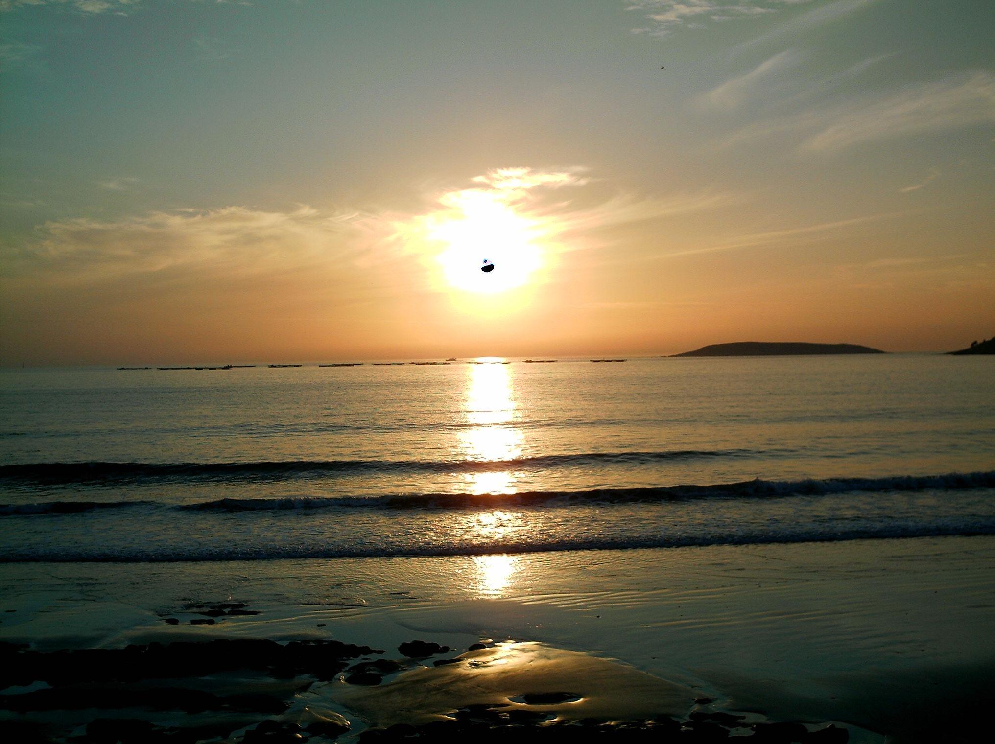 Foto playa Area Fofa. Puesta de sol en Panxon