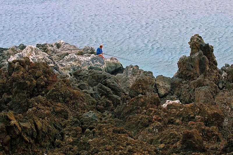 Foto playa La Restinga. Pescador